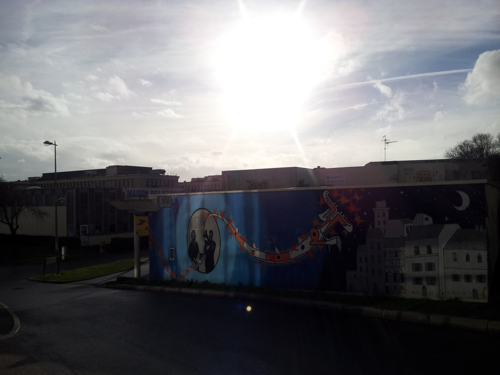 The graffiti mural on the side of the Maison de l'Etudiant, with a peek of rare sunshine!