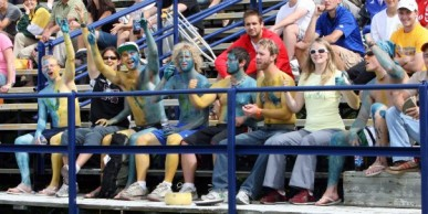 Students painted in blue and yellow at a soccer game.